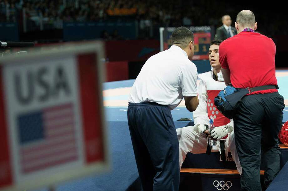 Steven Lopez of the USA gets direction from his coach Jean Lopez before the final round of his bout against Azerbaijan's Ramin Azizov in the men's 80-kg taekwondo competition at the 2012 London Olympics on Friday, Aug. 10, 2012. Photo: Smiley N. Pool, Houston Chronicle / © 2012  Houston Chronicle