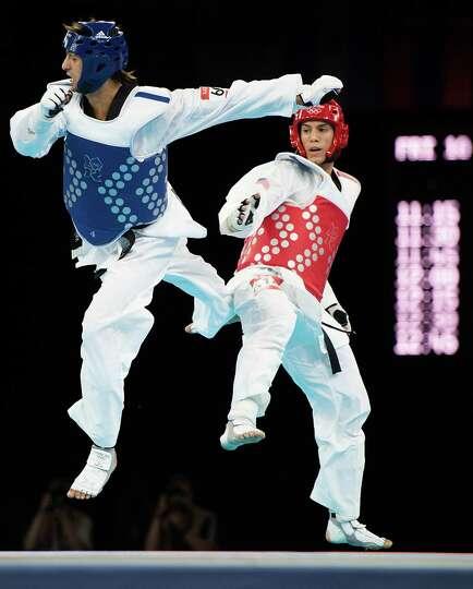 Steven Lopez of the USA, right, fights Azerbaijan's Ramin Azizov in the men's 80-kg taekwondo compet