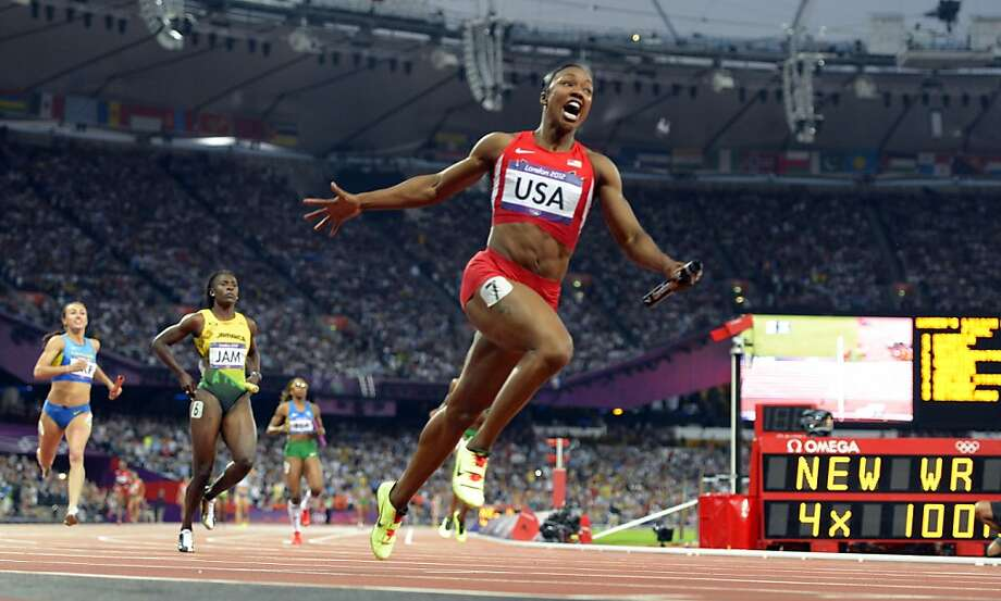 Carmelita Jeter leaps at the finish of the 4x100-meter relay, as the U.S. team broke a world record that had stood since 1985. Photo: Olivier Morin, AFP/Getty Images