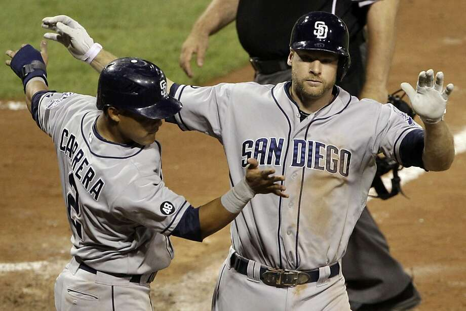 San Diego Padres' Chase Headley, right, celebrates with teammate Everth Cabrera (2) after hitting a two-run home run off Pittsburgh Pirates pitcher Tony Watson in the seventh inning. Photo: Gene J. Puskar, Associated Press