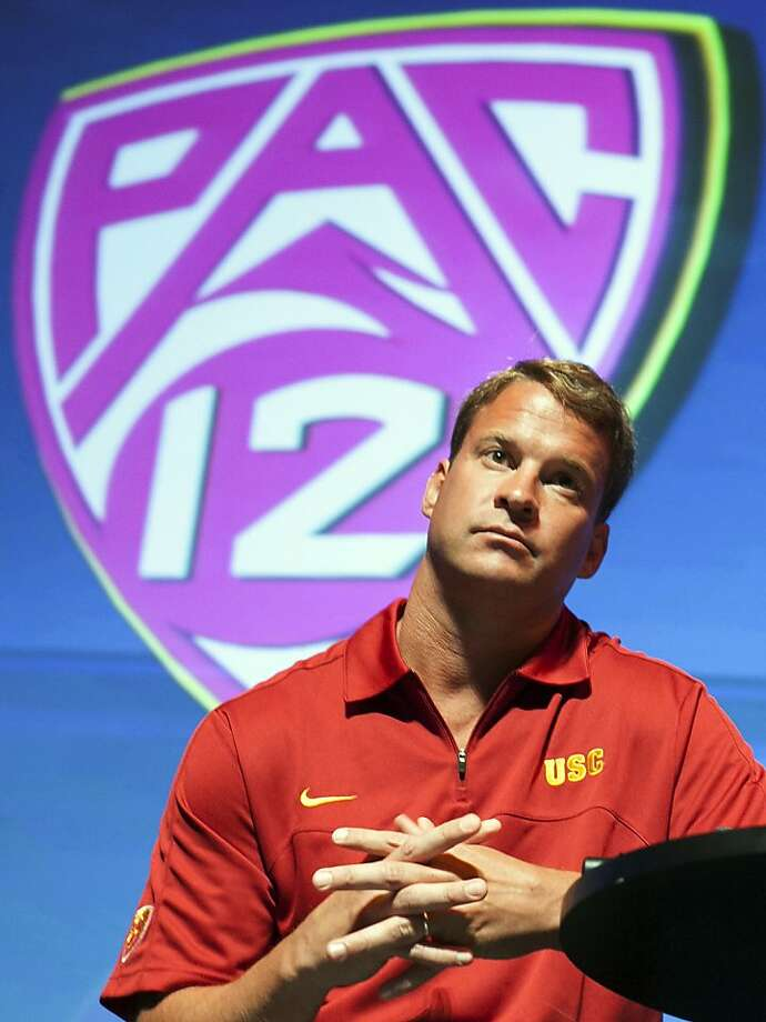 Southern California coach Lane Kiffin takes questions at the Pac-12 NCAA college football media day in Los Angeles, Tuesday, July 24, 2012. (AP Photo/Damian Dovarganes) Photo: Damian Dovarganes, Associated Press