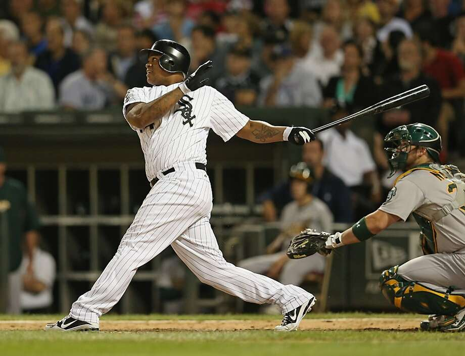 Dayan Viciedo of the Chicago White Sox hits the game-tying solo home run in the 7th inning against the Oakland Athletics at U.S. Cellular Field on Friday. Photo: Jonathan Daniel, Getty Images