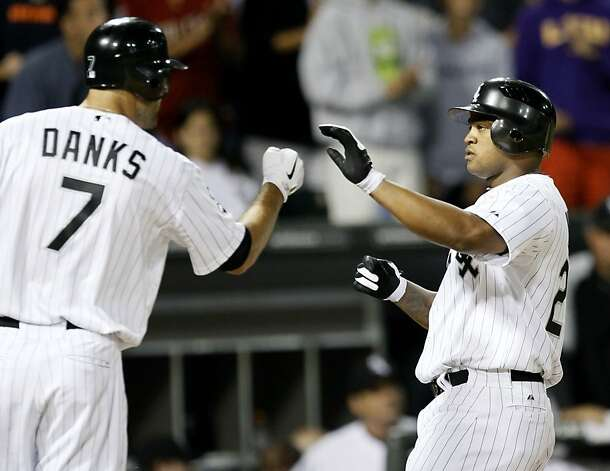 Chicago White Sox's Jordan Danks (7) greets Dayan Viciedo at home after Viciedo's home run off Oakland Athletics starting pitcher Brandon McCarthy during the seventh inning of a baseball game Friday, Aug. 10, 2012, in Chicago. (AP Photo/Charles Rex Arbogast) Photo: Charles Rex Arbogast, Associated Press