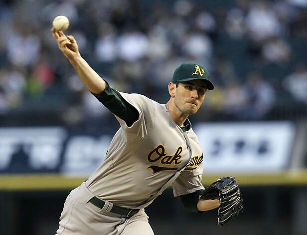 Oakland Athletics starting pitcher Brandon McCarthy delivers during the first inning of a baseball game against the Chicago White Sox on Friday, Aug. 10, 2012, in Chicago. (AP Photo/Charles Rex Arbogast) Photo: Charles Rex Arbogast, Associated Press