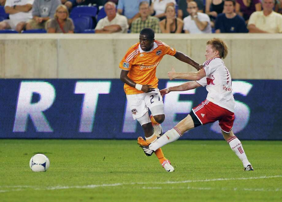 The Dynamo's Boniek Garcia, left, found the scoring chances few and far between in Friday's loss to Dax McCarty and the Eastern Conference-rival New York Red Bulls. Photo: Andy Marlin / 2012 Getty Images