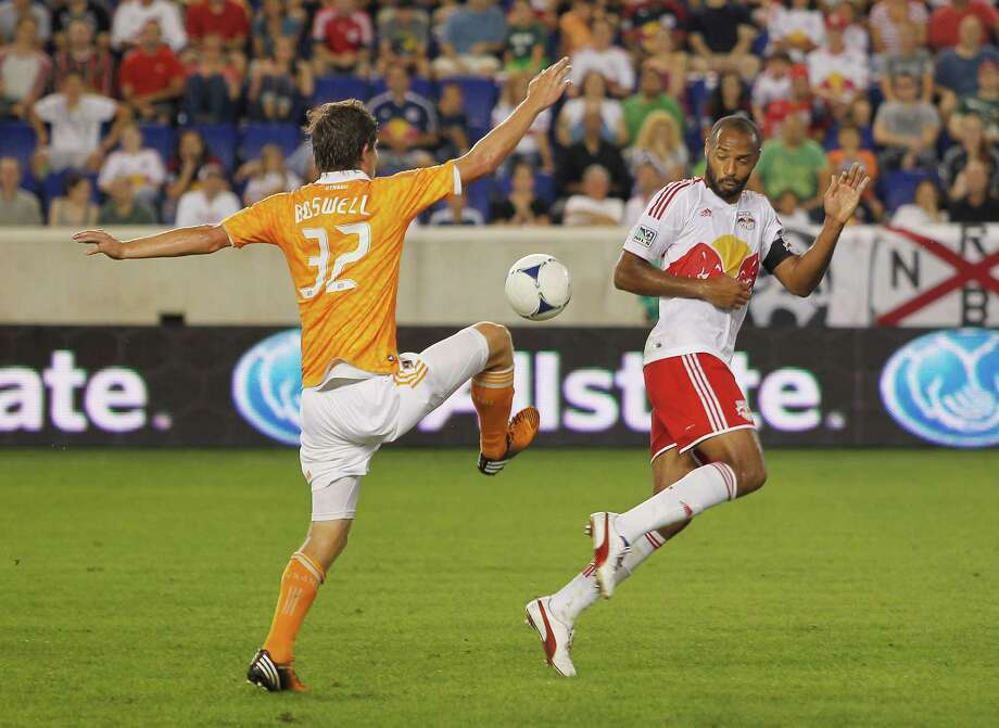 Bobby Boswell and Thierry Henry look to take possession. Photo: Andy Marlin, Getty Images / 2012 Getty Images