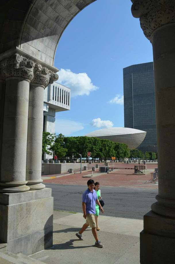 With The Egg in the background, tourists enjoy walks around the  Downtown Albany in summertime, when it's a peaceful place after the busy weekdays. This photo is taken from the  arches at the state Capitol building. (Guendolyn Chacon.)