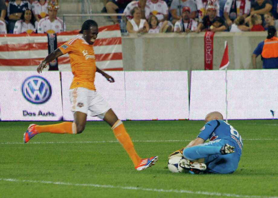 Macoumba Kandji is stopped on a breakaway by Red Bulls' goalkeeper Bill Gaudette. Photo: Andy Marlin, Getty Images / 2012 Getty Images