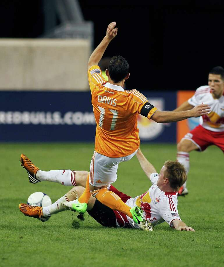 Brad Davis and Dax McCarty battle for possession. Photo: Andy Marlin, Getty Images / 2012 Getty Images