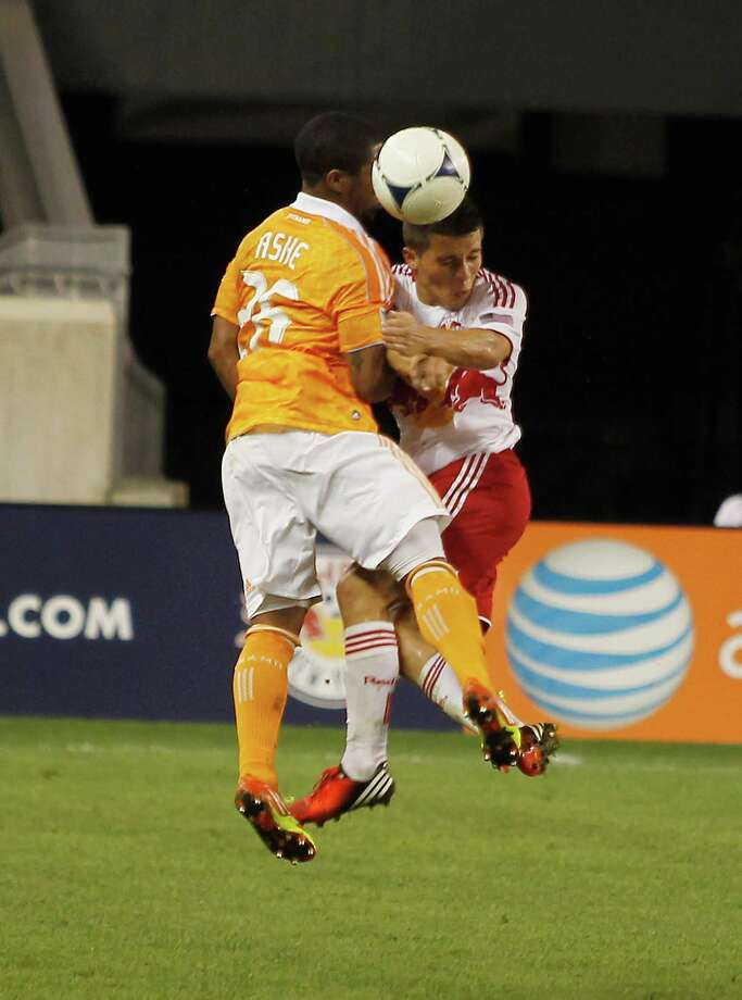 Corey Ashe and Connor Lade go up for a header. Photo: Andy Marlin, Getty Images / 2012 Getty Images