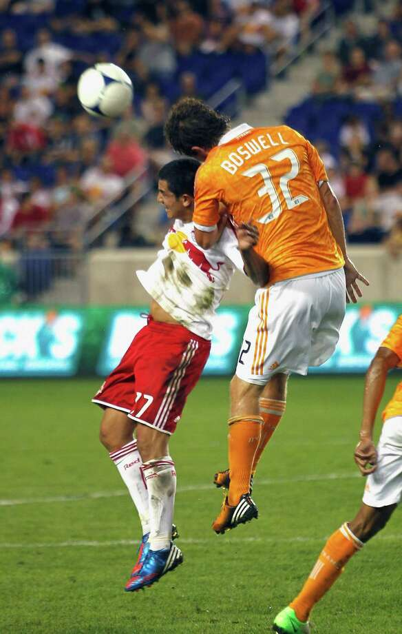 Bobby Boswell and Tim Cahill put their heads on the line. Photo: Andy Marlin, Getty Images / 2012 Getty Images