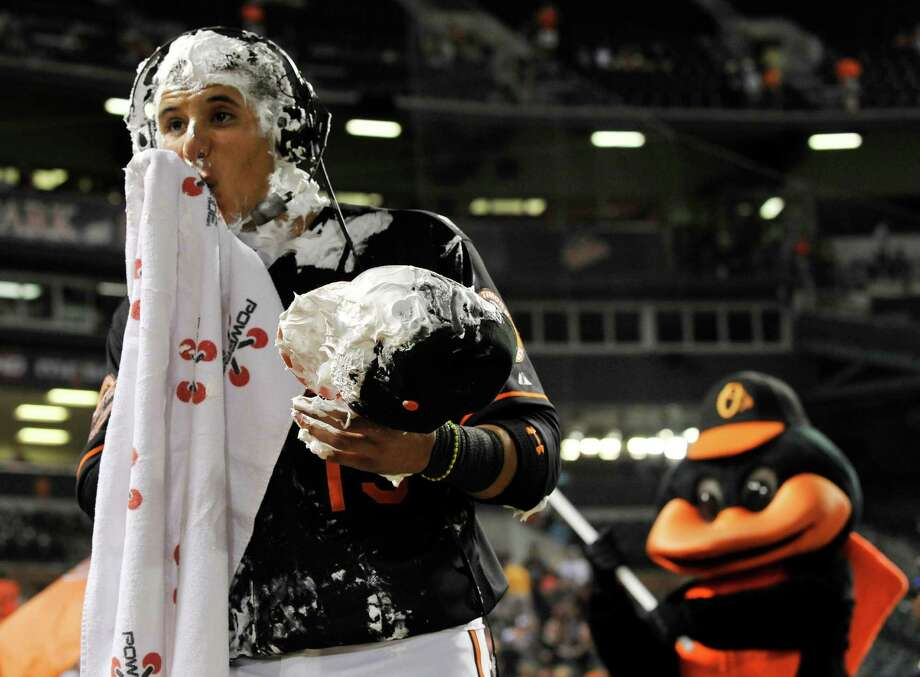 Orioles rookie Manny Machado took a shaving-cream pie to the face after becoming the youngest player in team history to record a multi-homer game. Photo: Gail Burton / FR4095 AP