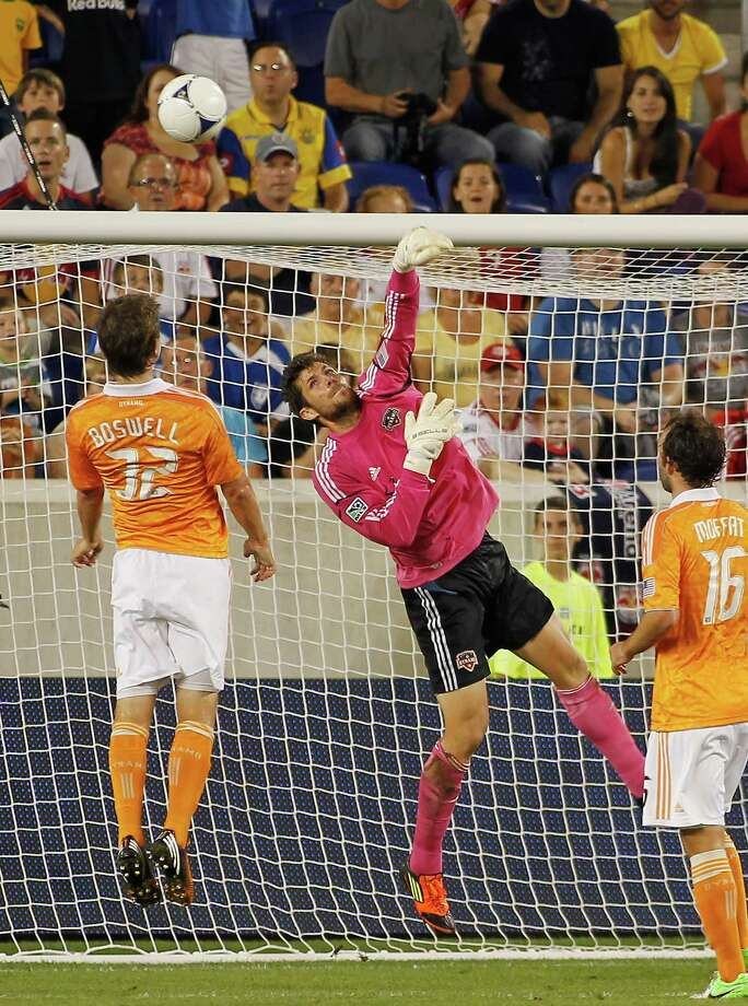 Dynamo goalkeeper Tally Hall deflects the ball for a save. Photo: Andy Marlin, Getty Images / 2012 Getty Images