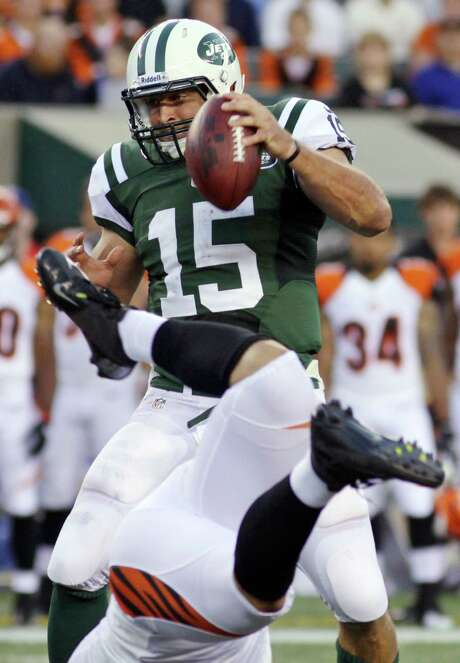 Tim Tebow completed only four passes and threw an interception for the Jets on Friday. Photo: Tom Uhlman / FR31154 AP