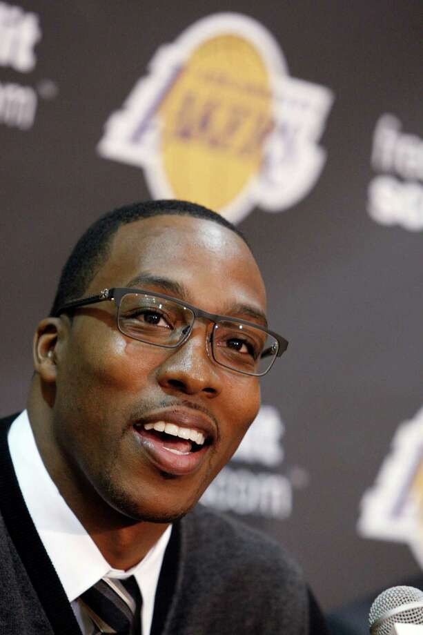Center Dwight Howard, newly acquired by the Los Angeles Lakers from the Orlando Magic, speaks at a news conference at the NBA basketball team's headquarters in El Segundo, Calif., Friday, Aug. 10, 2012. (AP Photo/Reed Saxon) Photo: Reed Saxon