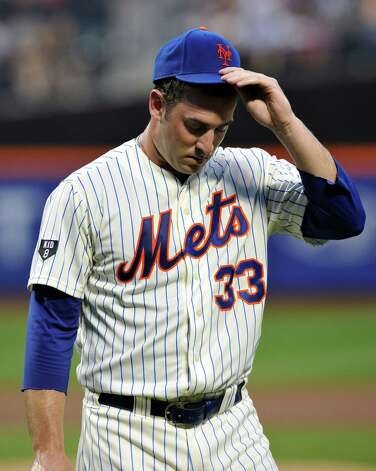 New York Mets pitcher Matt Harvey heads to the dugout after the first inning of a baseball game against the Atlanta Braves on Friday, Aug. 10, 2012, in New York. (AP Photo/Bill Kostroun) Photo: Bill Kostroun