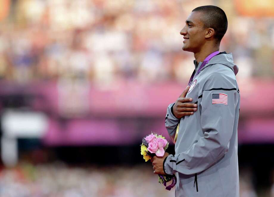 United States' Ashton Eaton listens to the U.S. national anthem after being presented with a gold medal in the men's decathlon during the athletics in the Olympic Stadium at the 2012 Summer Olympics, London, Friday, Aug. 10, 2012. (AP Photo/Matt Slocum) Photo: Matt Slocum