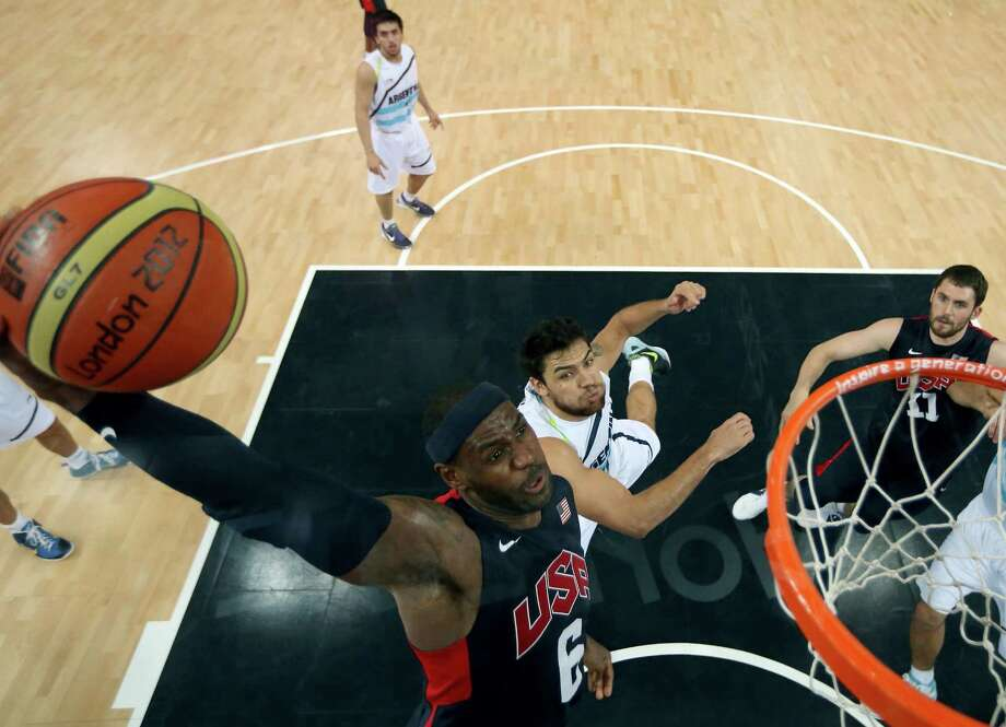 LeBron James (6) of the United States goes up for a dunk over Carlos Delfino (10) of Argentina during a men's semifinal basketball game at the 2012 Summer Olympics on Friday, Aug. 10, 2012, in London. (AP Photo/Christian Petersen, Pool) Photo: Christian Petersen
