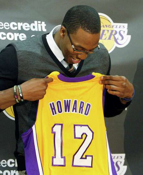 Dwight Howard is a believer after seeing his new jersey. Photo: Reed Saxon / AP