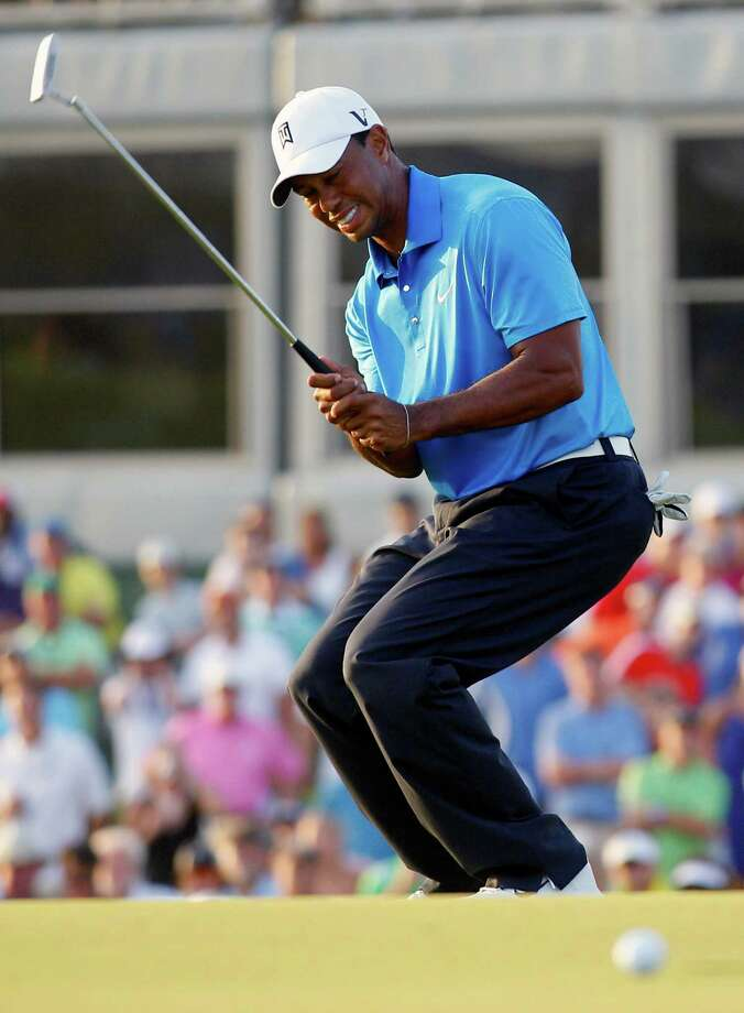 Tiger Woods reacts to his missed putt on the 18th green during the second round of the PGA Championship golf tournament on the Ocean Course of the Kiawah Island Golf Resort in Kiawah Island, S.C., Friday, Aug. 10, 2012. (AP Photo/Chuck Burton) Photo: Chuck Burton