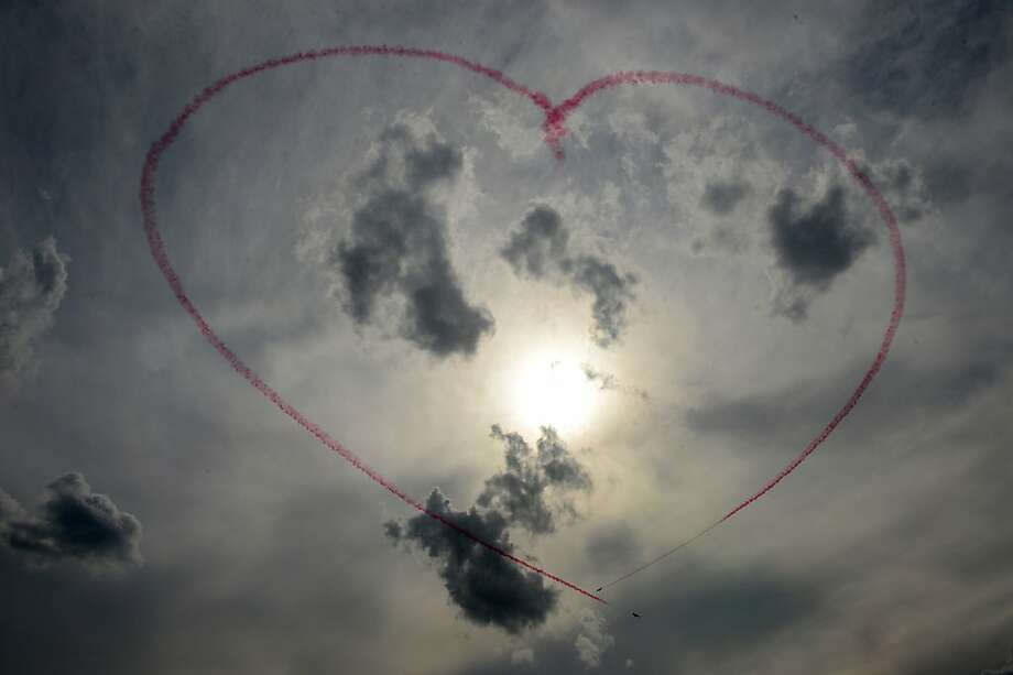 Members of the Red Arrows aerobatic team from the United Kingdom shape a heart with smoke as they perform on August 10, 2012, during the rehearsal of a flight show in Zhukovsky, outside Moscow. Photo: Natalia Kolesnikova, AFP/Getty Images