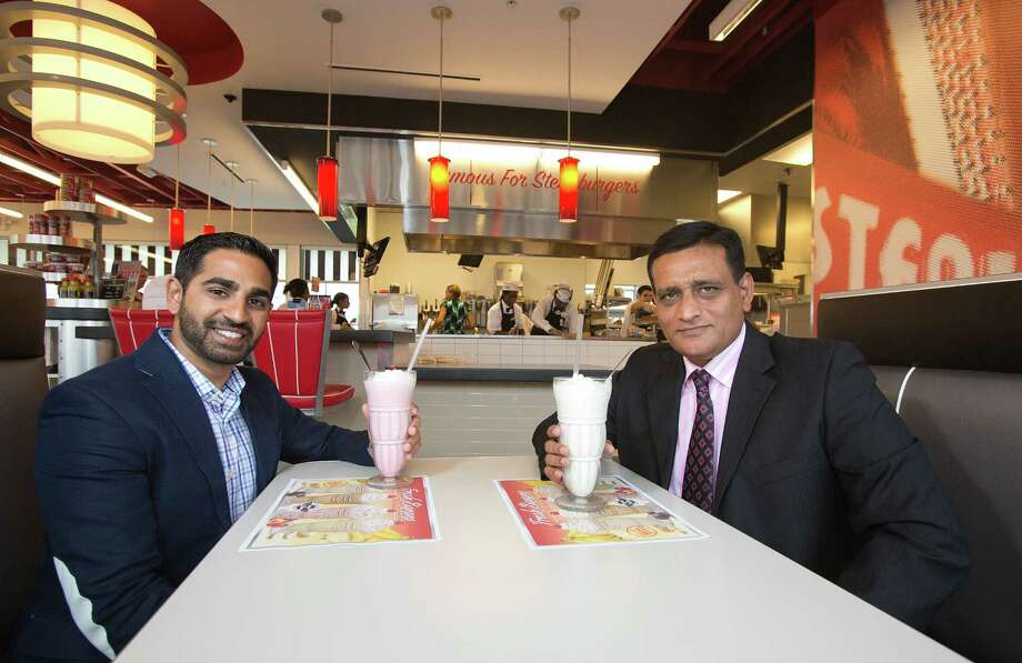 Anil Mohammed, left, vice president, and Moez Dhuka, president of SNS Franchise Ventures, expect to do more than just sip  at success with their new Shake 'n Steak location in Pearland. Mohammed says he became a loyal customer at college in Atlanta. Photo: Thomas B. Shea / © 2012 Thomas B. Shea