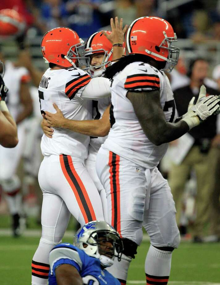 Cleveland Browns kicker Jeff Wolfert, center, is congratulated by teammate Spencer Lanning (5) after kicking the game-winning field goal during the second half of an NFL preseason football game in Detroit, Friday, Aug. 10, 2012. (AP Photo/Carlos Osorio) Photo: Carlos Osorio