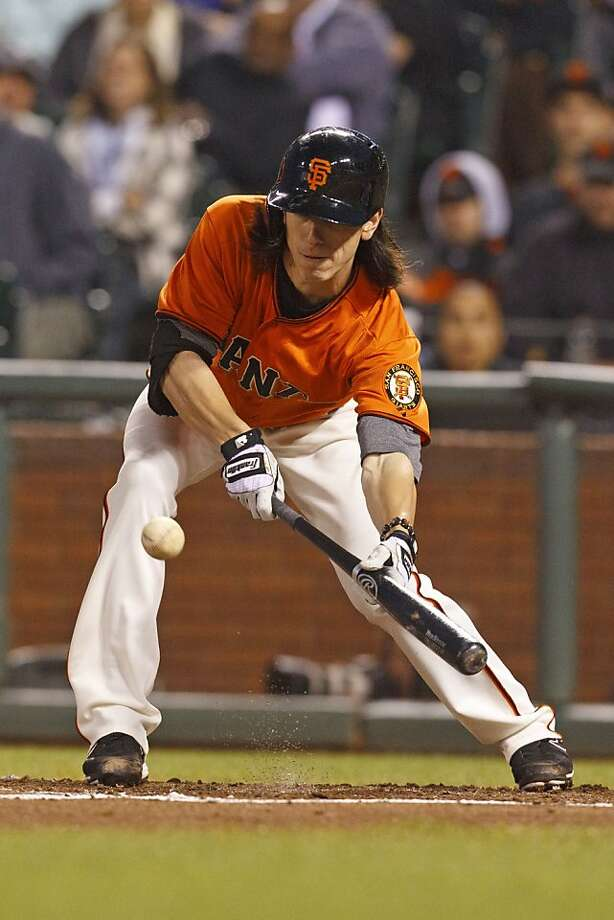 Tim Lincecum lays down a sacrifice bunt in the third inning Friday, but he was unable to do the same in the fifth. Photo: Jason O. Watson, Getty Images