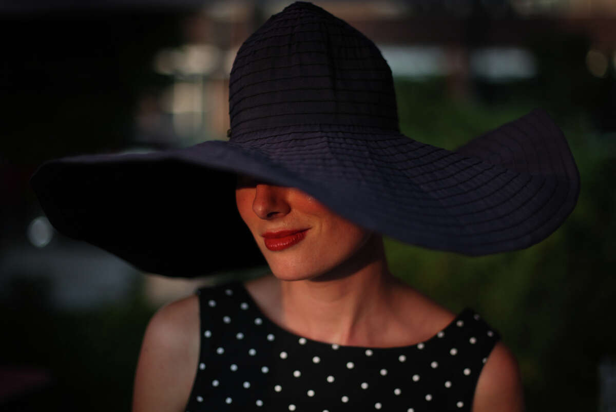 Teresa Elizabeth of La Toscanella wears an elegant hat during the South Lake Union Block Party.