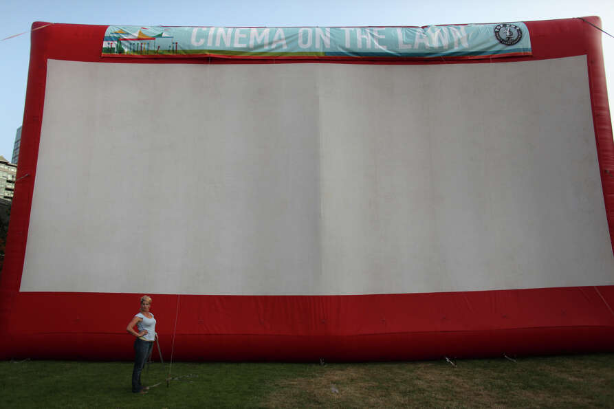 A giant, inflatable movie screen is readied for a showing of the movie