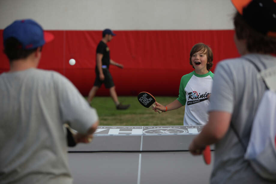Liam Chaitin, 9, plays table tennis against two opponents during the South Lake Union Block Party. Photo: JOSHUA TRUJILLO / SEATTLEPI.COM