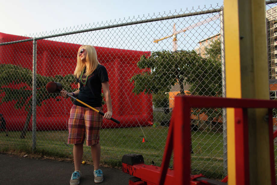 Taylor Healy, 15, holds onto a hammer while playing a game in the kids' area during the South Lake Union Block Party. Photo: JOSHUA TRUJILLO / SEATTLEPI.COM