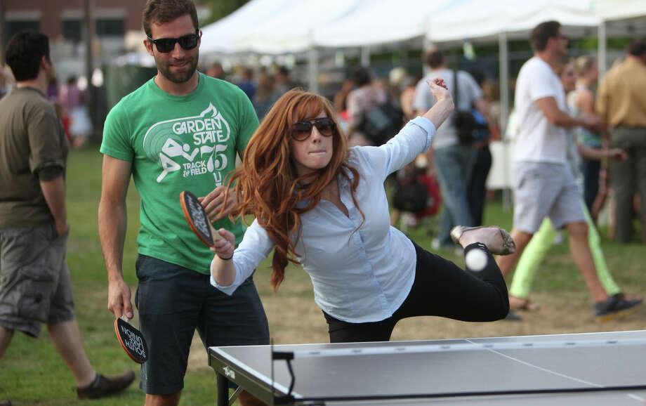 Keian Christopher and Emily Freney play table tennis. Photo: JOSHUA TRUJILLO / SEATTLEPI.COM