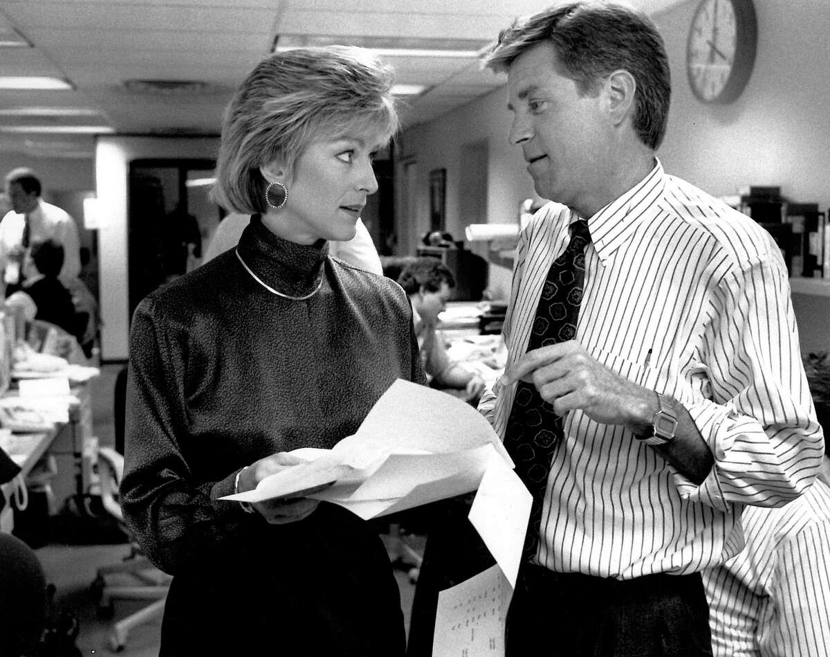 Kathi Goertzen and Dan Lewis go over a script for a May 17, 1991 news broadcast.