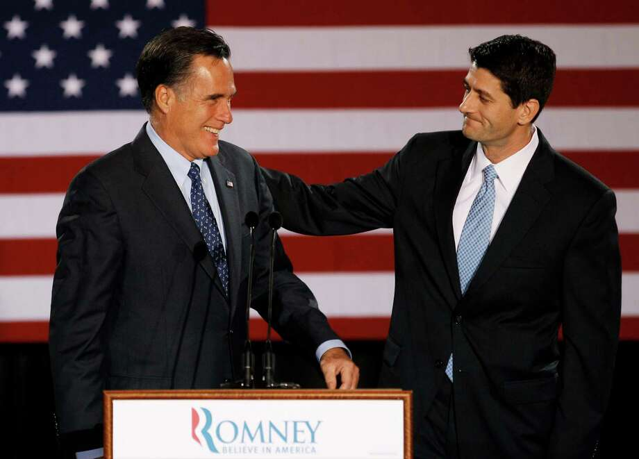 FILE - House Budget Committee Chairman Rep. Paul Ryan, R-Wis. introduces Republican presidential candidate, former Massachusetts Gov. Mitt Romney before Romney spoke at the Grain Exchange in Milwaukee, in this April 3, 2012 file photo. Romney has picked Wisconsin congressman Paul Ryan to be his running mate, according to a Republican with knowledge of the development. They will appear together Saturday Aug. 11, 2012 in Norfolk, Va., at the start of a four-state bus tour to introduce the newly minted GOP ticket to the nation.  (AP Photo/M. Spencer Green, File) Photo: M. Spencer Green