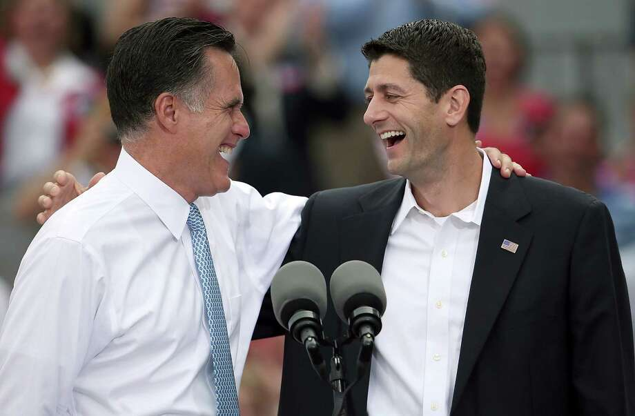 "Republican presidential candidate, former Massachusetts Gov. Mitt Romney (L) jokes with Rep. Paul Ryan (R-WI) (R) after announcing him as the ""next PRESIDENT of the United States"" during an event announcing him as his running mate in front of the USS Wisconsin August 11, 2012 in Norfolk, Virginia. Ryan, a seven term congressman, is Chairman of the House Budget Committee and provides a strong contrast to the Obama administration on fiscal policy. Photo: Win McNamee, Getty Images / 2012 Getty Images"