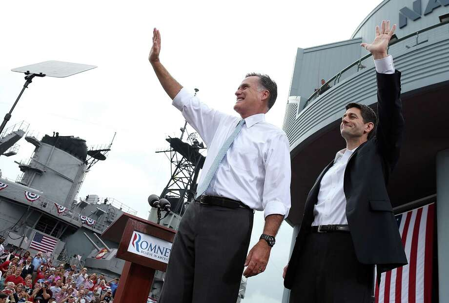 NORFOLK, VA - AUGUST 11:  Republican presidential candidate, former Massachusetts Gov. Mitt Romney (L) and U.S. Rep. Paul Ryan (R-WI) (R) wave as Ryan is announced as his running mate aboard the USS Wisconsin August 11, 2012 in Norfolk, Virginia. Ryan, a seven term congressman, is Chairman of the House Budget Committee and provides a strong contrast to the Obama administration on fiscal policy.  (Photo by Justin Sullivan/Getty Images) Photo: Justin Sullivan, Getty Images / 2012 Getty Images