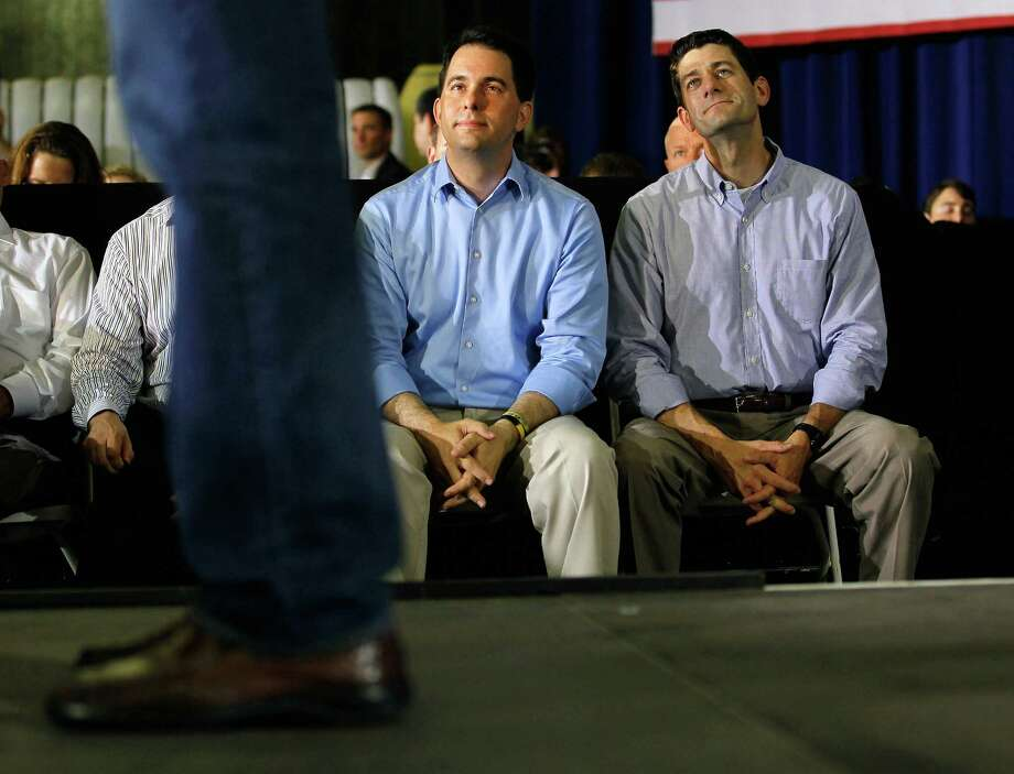 JANESVILLE, WI - JUNE 18:   Wisconsin Governor Scott Walker, (L) and Rep. Paul Ryan (R-WI), listen as Republican presidential candidate, former Massachusetts Gov. Mitt Romney speaks during a campaign event at Monterey Mills on June 18, 2012 in Janesville, Wisconsin.  Mr. Romney continues hs campaign swing through battle ground states as he battles President Barack Obama for votes.  (Photo by Joe Raedle/Getty Images) Photo: Joe Raedle, Getty Images / 2012 Getty Images