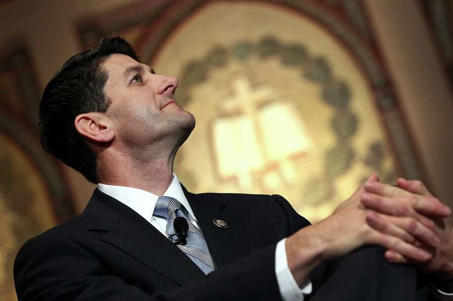 """WASHINGTON, DC - APRIL 26:  House Budget Chairman Rep. Paul Ryan (R-WI) is introduced before speaking about """"America's Enduring Promise,"""" and the federal budget, in a speech at Georgetown University April 26, 2012 in Washington, DC. During his speech, Ryan said that his proposed budget confronts the nation's growing $15 trillion debt before it impacts future generations of Americans.  (Photo by Win McNamee/Getty Images) Photo: Win McNamee, Getty Images / 2012 Getty Images"""