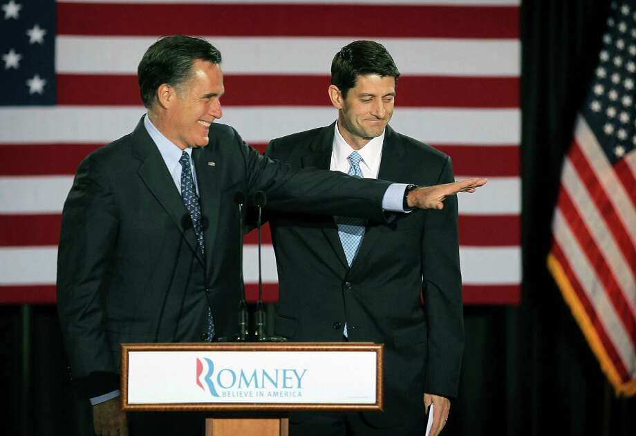 MILWAUKEE, WI - APRIL 03:  Republican presidential candidate, former Massachusetts Governor Mitt Romney (L) is introduced by Wisconsin Congressman Paul Ryan at an election-night rally April 3, 2012 in Milwaukee, Wisconsin. According to early results, Romney won the D.C, Maryland and Wisconson primaries today with a total of 98 delegates at stake. (Photo by Scott Olson/Getty Images) Photo: Scott Olson, Getty Images / 2012 Getty Images