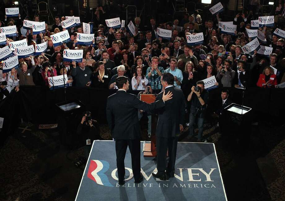 MILWAUKEE, WI - APRIL 03:  Republican presidential candidate, former Massachusetts Gov. Mitt Romney (R) is greeted by U.S. Rep Paul Ryan (R-WI) before speaking to supporters during his primary night gathering at The Grain Exchange on April 3, 2012 in Milwaukee, Wisconsin. Mitt Romney addressed supporters after winning primary elections in Wisconsin, Maryland and the District of Columbia.  (Photo by Justin Sullivan/Getty Images) Photo: Justin Sullivan, Getty Images / 2012 Getty Images