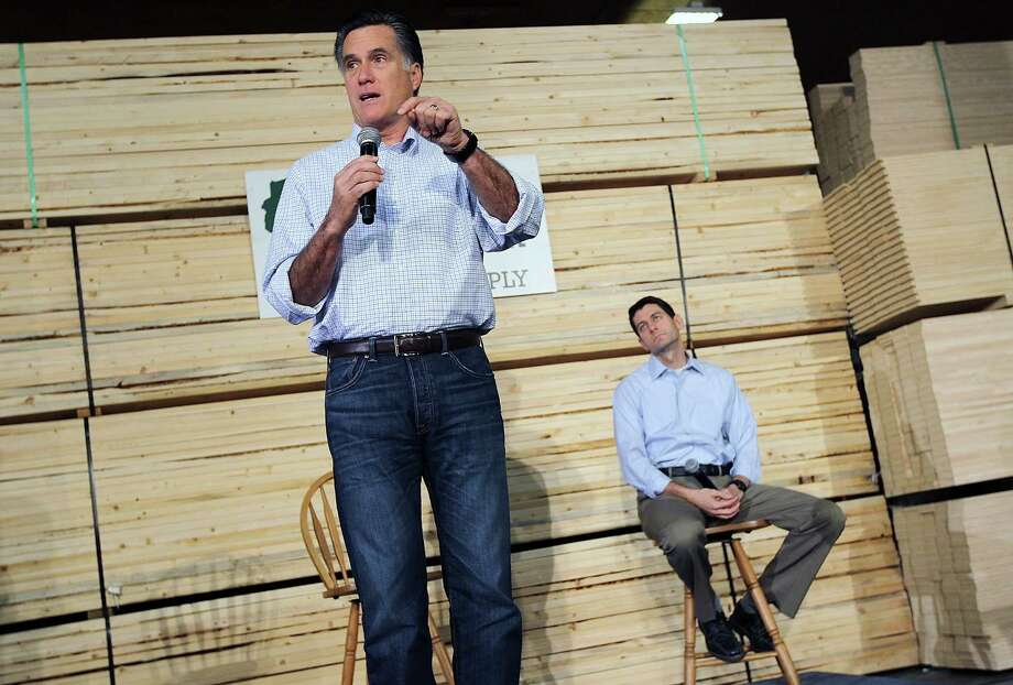 GREEN BAY, WI - APRIL 02:  Republican Presidential candidate, former Massachusetts Gov. Mitt Romney (L) speaks during a town hall style meeting as U.S. Rep Paul Ryan (R-WI) looks on at Wisconsin Building Supply on April 2, 2012 in Green Bay, Wisconsin. With one day to go before the Wisconsin primary, Mitt Romney makes a final push through the state.  (Photo by Justin Sullivan/Getty Images) Photo: Justin Sullivan, Getty Images / 2012 Getty Images