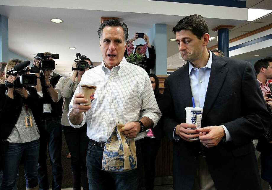 JOHNSON CREEK, WI - APRIL 01:  Republican Presidential candidate, former Massachusetts Gov. Mitt Romney (L) and U.S. Rep. Paul Ryan (R-WI) hold bags of food at a Culver's restaurant on April 1, 2012 in Johnson Creek, Wisconsin. With less than a week before the Wisconsin primary, Mitt Romney continues to campaign through the state.  (Photo by Justin Sullivan/Getty Images) Photo: Justin Sullivan, Getty Images / 2012 Getty Images