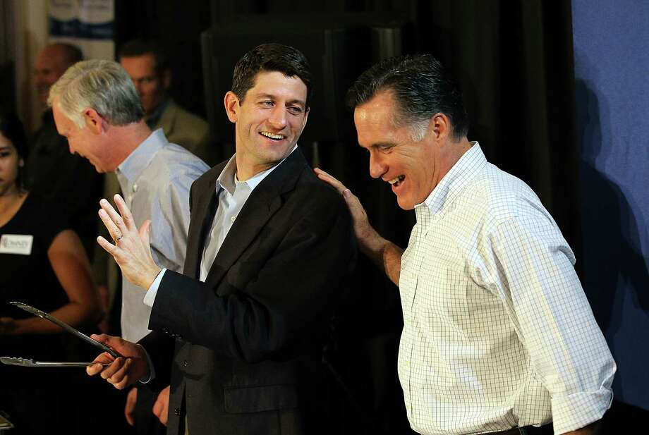 MILWAUKEE, WI - APRIL 01:  Republican Presidential candidate, former Massachusetts Gov. Mitt Romney (R) jokes with U.S. Rep Paul Ryan (C) (R-WI) during a pancake brunch at Bluemound Gardens on April 1, 2012 in Milwaukee, Wisconsin. With less than a week before the Wisconsin primary, Mitt Romney continues to campaign through the state.  (Photo by Justin Sullivan/Getty Images) Photo: Justin Sullivan, Getty Images / 2012 Getty Images