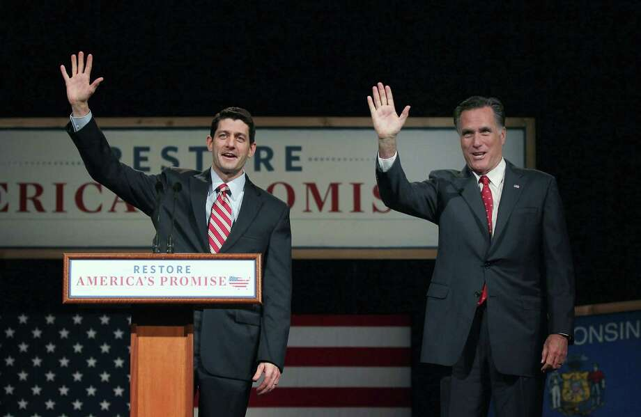 APPLETON, WI - MARCH 30:  U.S. Rep. Paul Ryan (R-WI) waves with Republican Presidential candidate and former Massachusetts Gov. Mitt Romney after he introduced Romney at a campaign stop at Lawrence University March 30, 2012 in Appleton, Wisconsin. Wisconsin residents will go to the polls on April 3 to vote for their choice for the Republican presidential nominee.  (Photo by Scott Olson/Getty Images) Photo: Scott Olson, Getty Images / 2012 Getty Images