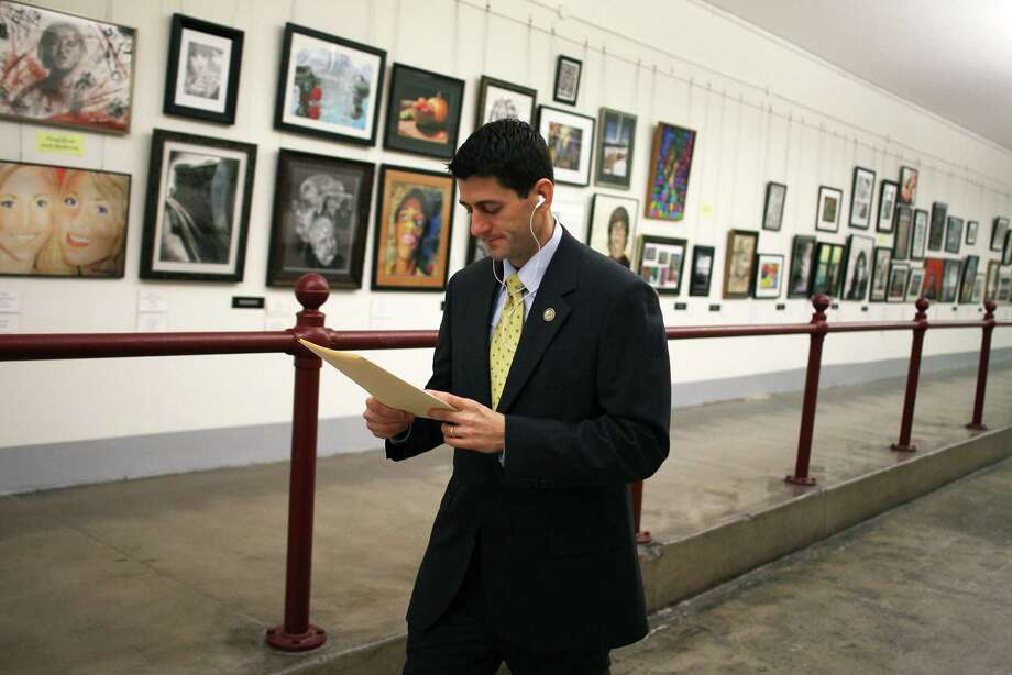 WASHINGTON, DC - FEBRUARY 17: House Budget Committee Chairman Rep. Paul Ryan (R-WI) walks through the Cannon tunnel on his way to the U.S. Capitol Building, on February 17, 2012 in Washington, DC. Later today the House and Senate are scheduled to vote on the bipartisan deal extending the payroll tax cut and unemployment benefits. (Photo by Mark Wilson/Getty Images) Photo: Mark Wilson, Getty Images / 2012 Getty Images