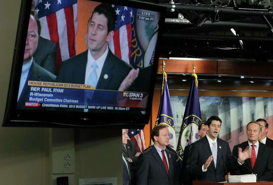 WASHINGTON, DC - APRIL 05:  U.S. Rep. Paul Ryan (R-WI) (C), chairman of the House Budget Committee, speaks during a news conference April 5, 2011 on Capitol Hill in Washington, DC. House Republicans have unveiled their version of the budget proposal for FY 2012 which would cut government spending $6.2 tillion more in 10 years than the version by the Obama Administration.  (Photo by Alex Wong/Getty Images) Photo: Alex Wong, Getty Images / 2011 Getty Images