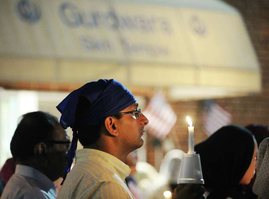 Punit Pujara of Darien during the Vigil and Interfaith Prayer Service at the Norwalk Gurudwara, Friday night, Aug. 10, 2012. The vigil was held in memory of the Sikh victims of the shootings that took place in the Gurudwara in Oak Creek, Wisconsin. Photo: Bob Luckey / Greenwich Time