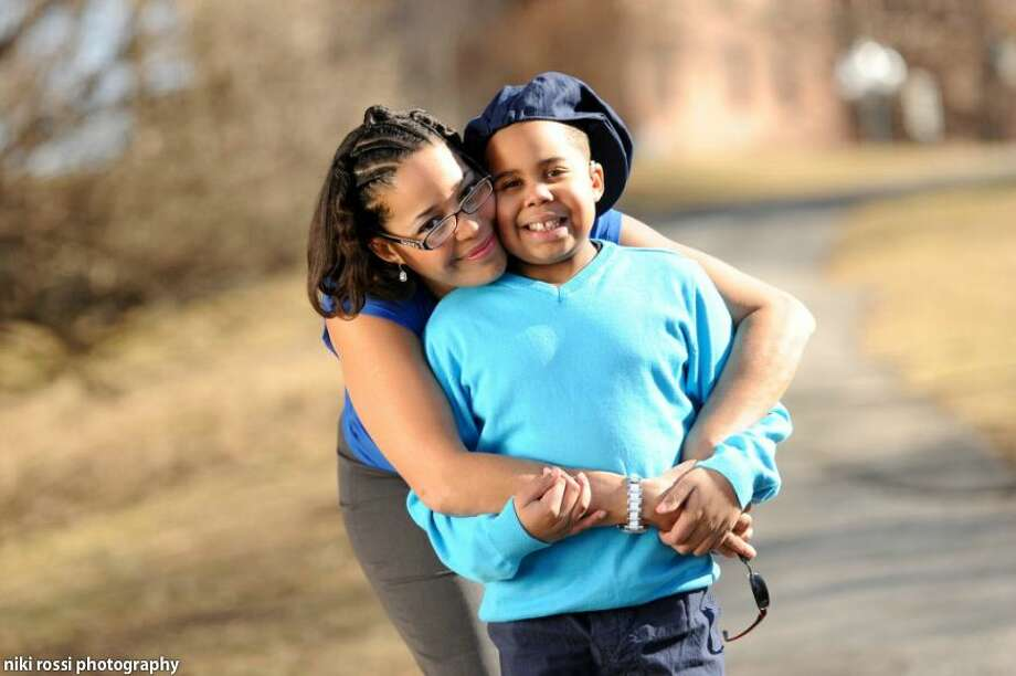 Laurel McAdoo hugs her son, Myles McAdoo. (Photo courtesy of McAdoo family) Photo: Kristen Hines