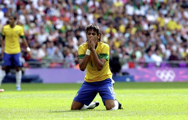 Brazil's Neymar reacts during the men's soccer final against Mexico at the 2012 Summer Olympics, Saturday, Aug. 11, 2012, in London. (AP Photo/Luca Bruno) Photo: Luca Bruno / AP